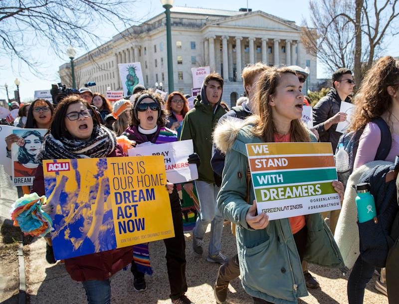 Deferred Action for Childhood Arrivals (DACA) recipients and other young immigrants walk with supporters outside the U.S. Capitol last March, when the program was threatened with extinction by President Trump.