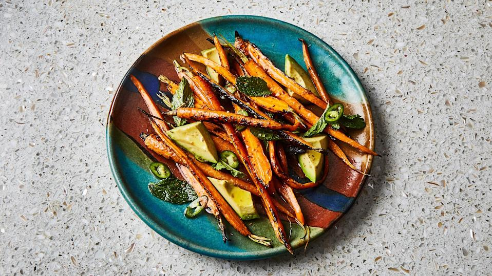 "You actually don't have to bother with peeling the carrots for this recipe—not only do the thin skins pack lots nutrients, but you'll also get a better char with them on. <a href=""https://www.bonappetit.com/recipe/grilled-carrots-with-avocado-and-mint?mbid=synd_yahoo_rss"" rel=""nofollow noopener"" target=""_blank"" data-ylk=""slk:See recipe."" class=""link rapid-noclick-resp"">See recipe.</a>"