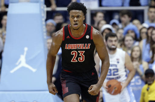 Louisville's Steven Enoch (23) reacts following a basket against North Carolina during the first half of an NCAA college basketball game in Chapel Hill, N.C., Saturday, Jan. 12, 2019. (AP Photo/Gerry Broome)