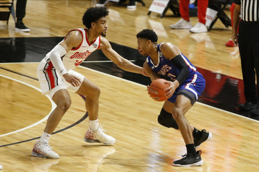 UMass-Lowell's Obadiah Noel, right, tries to dribble past Ohio State's Justice Sueing during the first half of an NCAA college basketball game Sunday, Nov. 29, 2020, in Columbus, Ohio. (AP Photo/Jay LaPrete)