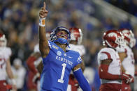 Kentucky quarterback Lynn Bowden Jr. (1) celebrates after throwing a touchdown pass during the second half of the team's NCAA college football game against Arkansas, Saturday, Oct. 12, 2019, in Lexington, Ky. (AP Photo/Bryan Woolston)