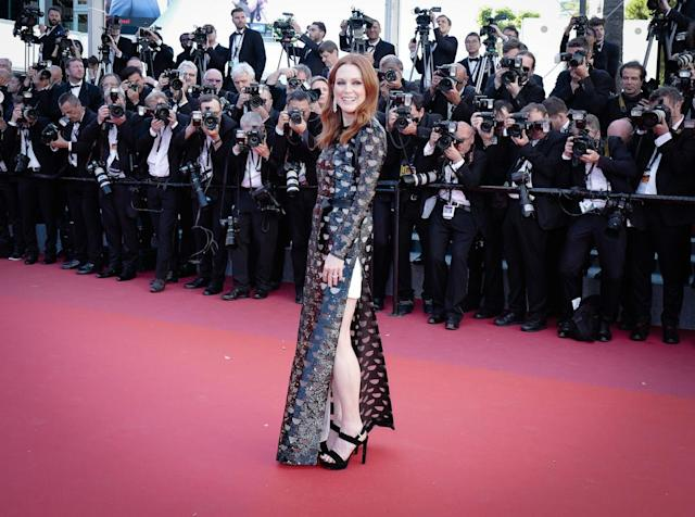 <p>Julianne Moore went laidback black tie style with a black and belted gown from Louis Vuitton. (Photo: Ki Price/Getty Images) </p>
