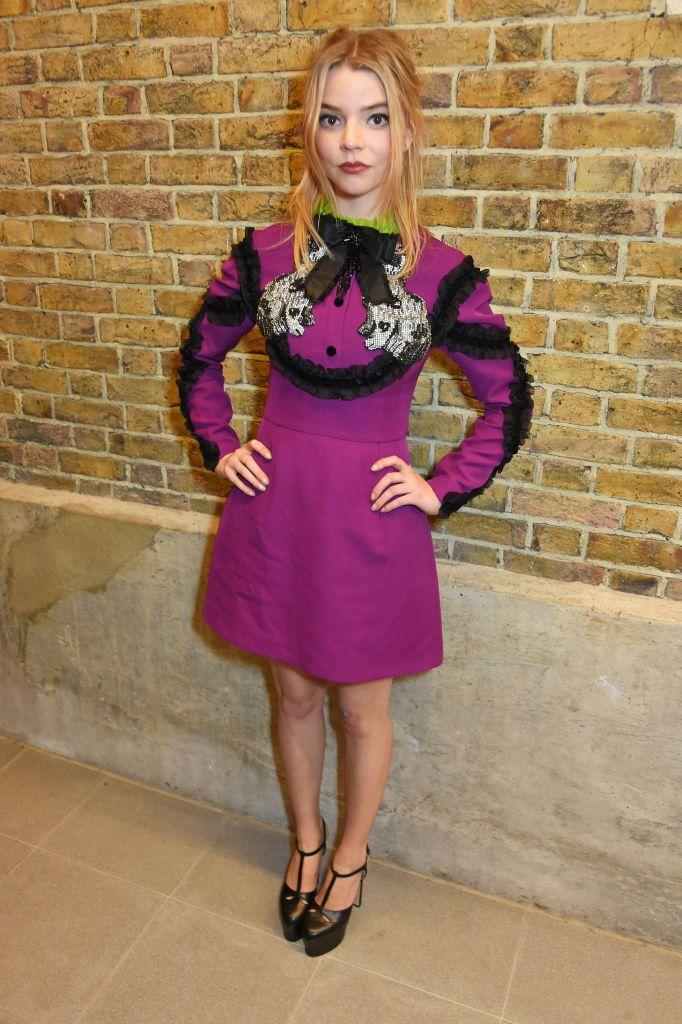<p>Taylor-Joy looked doll-like in a purple Gucci mini dress and super high platformed heels. </p>