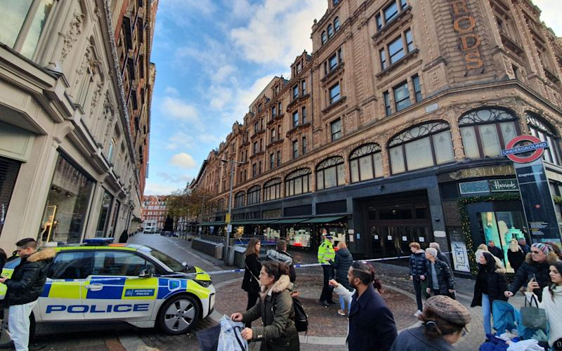 The scene in Knightsbridge, where a murder investigation has begun after a man was knifed to death near Harrods department store in a suspected robbery - PA