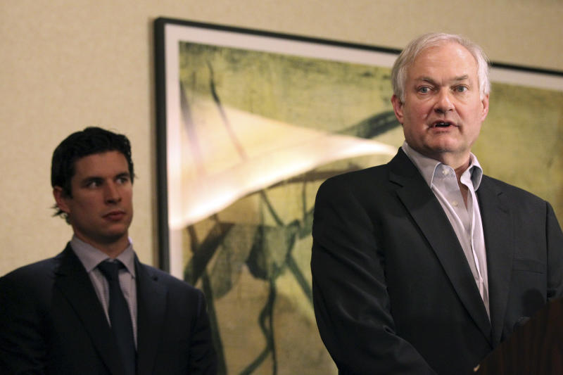 Pittsburgh Penguins' Sidney Crosby, left, listens as Don Fehr, executive director for the National Hockey League Players Associations, peaks to reporters, Thursday, Dec. 6, 2012 in New York. Talks in the NHL labor fight broke down after just one hour Thursday night, and it isn't known when the league and the players' association would get back together. (AP Photo/Mary Altaffer)