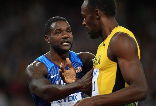 Justin Gatlin and Usain Bolt embrace at the World Championships. Pic: Getty