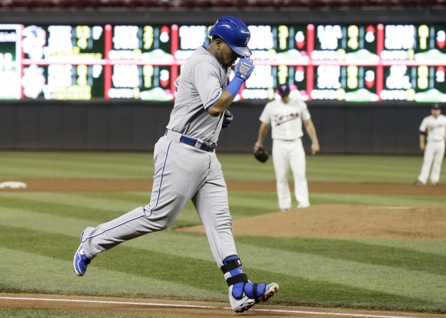 Kansas City Royals' Salvador Perez trots home with a two-run home run off Minnesota Twins pitcher Andrew Albers, center background, in the fourth inning of a baseball game, Wednesday, Aug. 28, 2013 in Minneapolis. (AP Photo/Jim Mone)