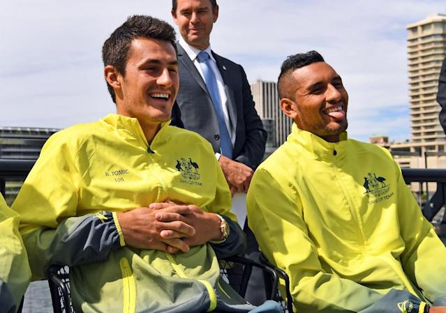 Nick Kyrgios (R) and Bernard Tomic have frequently fallen foul of tennis authorities and have a love-hate relationship with Australian public (AFP Photo/William West)