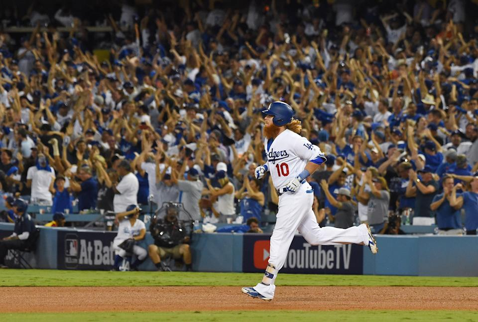 Dodgers third baseman Justin Turner rounds the bases after hitting a two-run home run against the Astros in the sixth inning. (USA TODAY Sports)