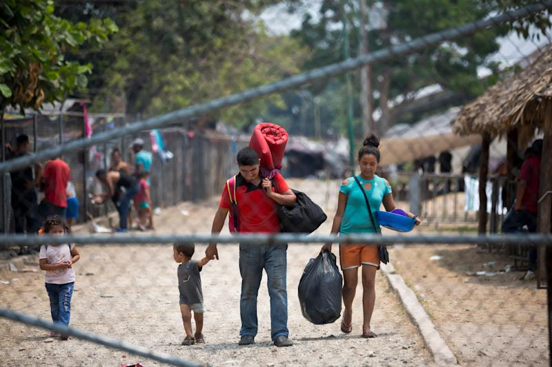Gribil Mejia Tinoco, from Santa Barbara, Honduras, center, with his wife Heidi and children, leaves a shelter where they stayed for one month before getting temporary permission to stay in Mexico, in Mapastepec, Chiapas state, Mexico, Sunday, April 28, 2019. This week, Central American migrants who traveled in caravans to the U.S. have begun receiving a Mexican government ID that allows them to stay for five years on Mexico's southern border with Guatemala, prompting them to leave the shelters. (AP Photo/Moises Castillo)
