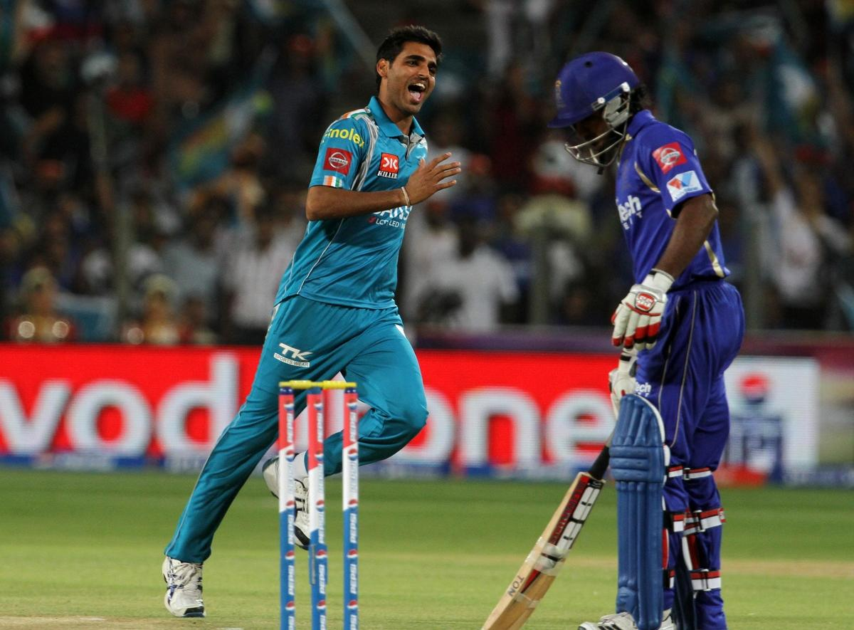 Pune Warriors player Bhuvneshwar Kumar celebrates after taking a wicket during match 13 of the Pepsi Indian Premier League ( IPL) 2013  between The Pune Warriors India and the Rajasthan Royals held at the Subrata Roy Sahara Stadium, Pune on the 11th April  2013..Photo by Vipin Pawar-IPL-SPORTZPICS ..Use of this image is subject to the terms and conditions as outlined by the BCCI. These terms can be found by following this link:..https://ec.yimg.com/ec?url=http%3a%2f%2fwww.sportzpics.co.za%2fimage%2fI0000SoRagM2cIEc&t=1506288678&sig=eeSBGRzw0MRZVfD_wre.Jg--~D