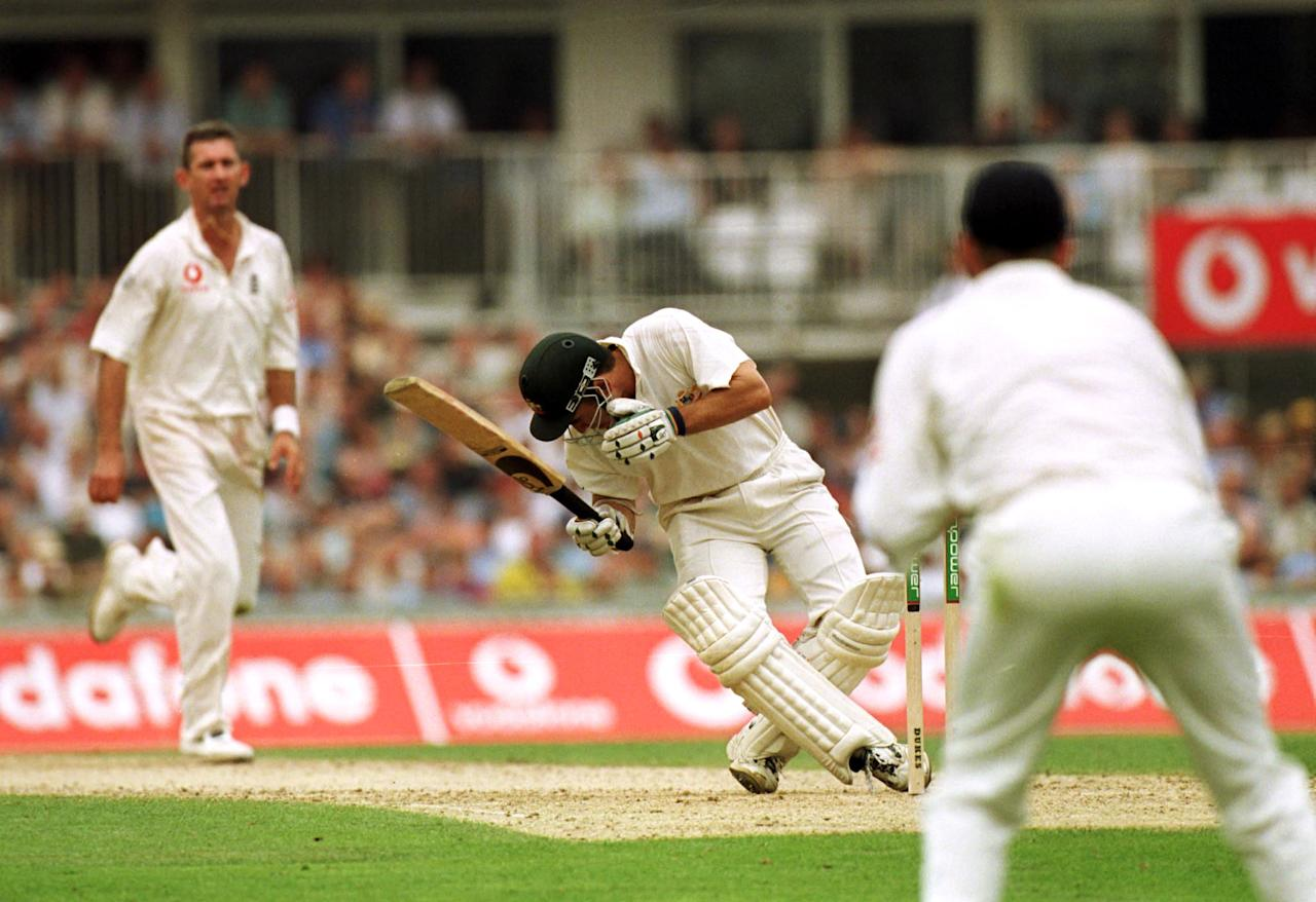 23 Aug 2001:  Justin Langer of Australia after a ball hit him on the head during the first day of the 5th Ashes Test between England and Australia at The AMP Oval, London. Mandatory Credit: Hamish Blair/ALLSPORT