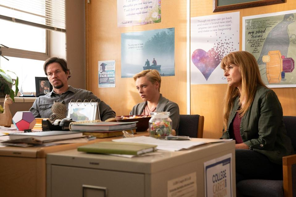 Jadin (Reid Miller, center) in a scene with parents Joe (Mark Wahlberg) and Lola (Connie Britton).
