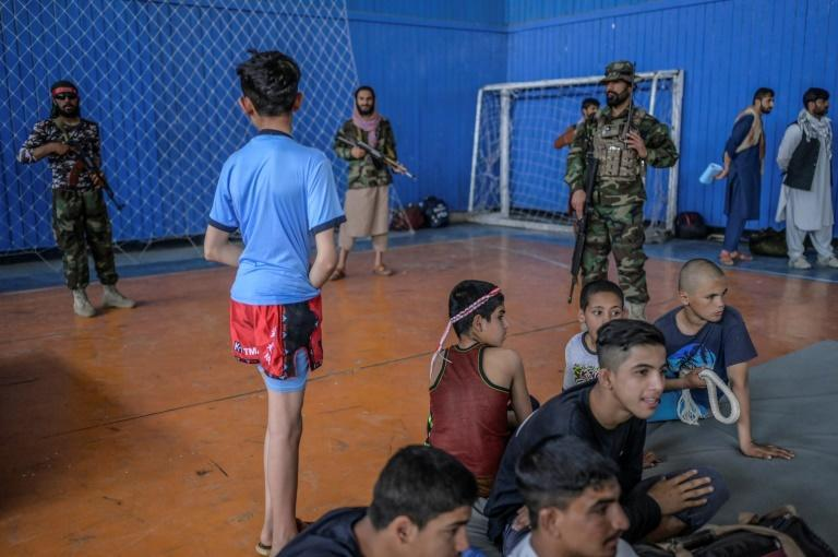 Youths wait to show off their skills during an event organised for the visit of Taliban's director general for sports and physical education Bashir Ahmad Rustamzai (AFP/BULENT KILIC)