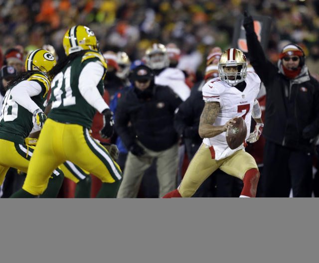 San Francisco 49ers quarterback Colin Kaepernick (7) scrambles for a first down against the Green Bay Packers defense during the second half of an NFL wild-card playoff football game, Sunday, Jan. 5, 2014, in Green Bay, Wis. The 49ers won 23-20. (AP Photo/Jeffrey Phelps)