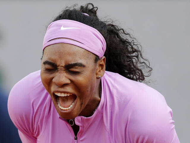 Serena Williams of the U.S. reacts as she plays Belarus' Victoria Azarenka during their third round match of the French Open tennis tournament at the Roland Garros stadium, Saturday, May 30, 2015 in Paris, France. (AP Photo/Christophe Ena)