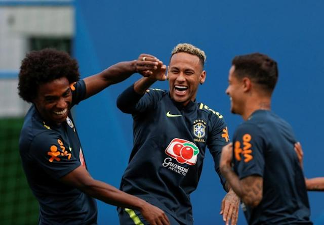 Coutinho with Willian (L) and Neymar at Brazil training on Tuesday