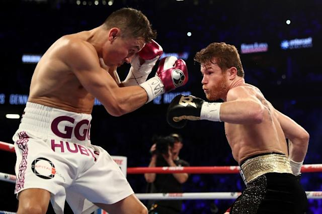 "Mexico's Saul ""Canelo"" Alvarez (R) showed skill and durability to end Gennady Golovkin's unbeaten reign as unified middleweight champion (AFP Photo/AL BELLO)"