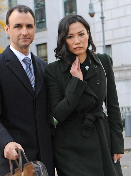 "Wendi Deng Murdoch arrives State Supreme court, Wednesday, Nov. 20, 2013, in New York. Deng Murdoch, and her husband, Rupert Murdoch, said they were parting with ""mutual respect"" Wednesday after telling a judge they had reached a divorce settlement. (AP Photo/ Louis Lanzano)"