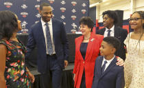 New Orleans Pelicans Governor Gayle Benson chats with Willie Green and his family after Green was introduced as the new head coach for the New Orleans Pelicans NBA basketball team, in Metairie, La., Tuesday, July 27, 2021. From left to right is Green's wife Terrah, Willie Green, Gayle Benson, son Ross, 21, daughter Aaliyah, 14, and son Mason, 9. (AP Photo/Ted Jackson)