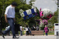 Large topiary of Miraitowa, the official mascot of Tokyo 2020 Olympics and Someity, the official mascot of Paralympics, are displayed at a Symbol Promenade Park Flower Plaza Wednesday, July 21, 2021, in Tokyo. (AP Photo/Kiichiro Sato)