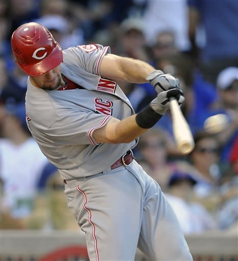 Cincinnati Reds' Ryan Ludwick doubles in two runs against the Chicago Cubs during the eighth inning of a baseball game Saturday, Aug. 11, 2012, in Chicago. (AP Photo/Jim Prisching)