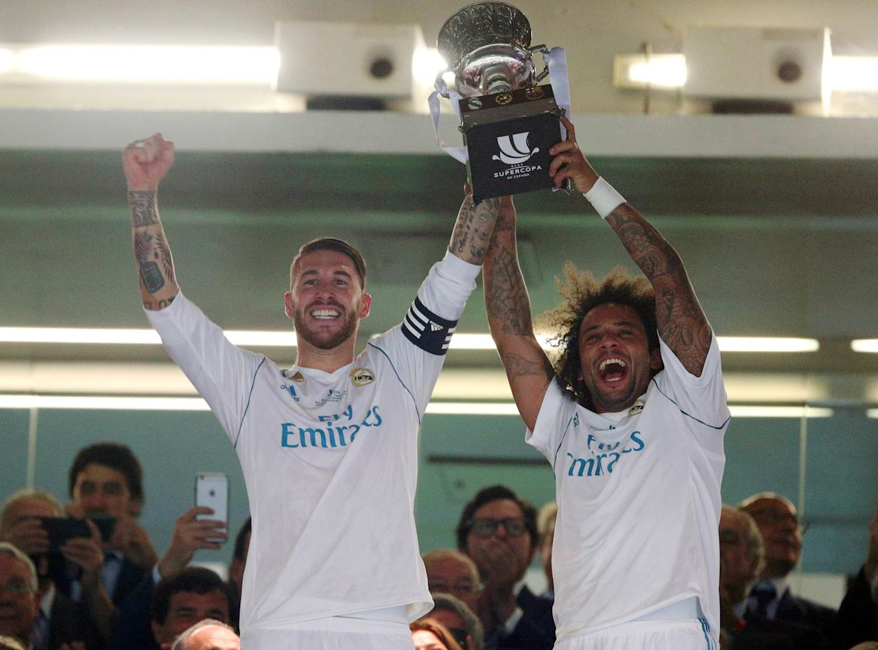 Soccer Football - Real Madrid vs Barcelona - Spanish Super Cup Second Leg - Madrid, Spain - August 17, 2017   Real Madrid's Sergio Ramos and Marcelo lift the trophy after winning the Spanish Super Cup      REUTERS/Sergio Perez     TPX IMAGES OF THE DAY