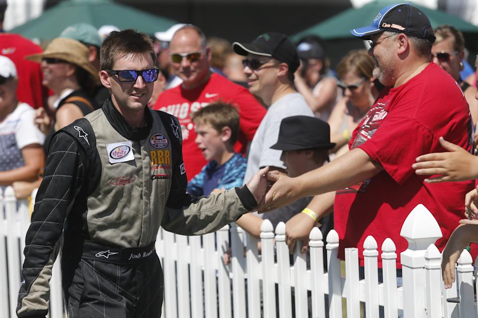 Josh Reaume is seen during driver introductions for the NASCAR Xfinity Series auto race at Mid-Ohio Sports Car Course Saturday, Aug. 15, 2015 in Lexington, Ohio. (AP Photo/Tom E. Puskar)