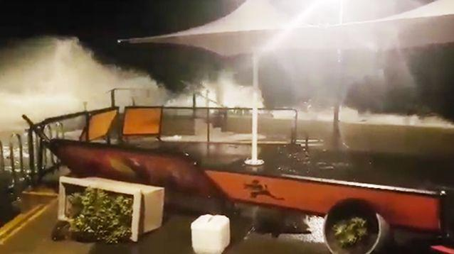 The swell sent waves crashing onto footpaths at Broadway in Glenelg. Photo: 7News