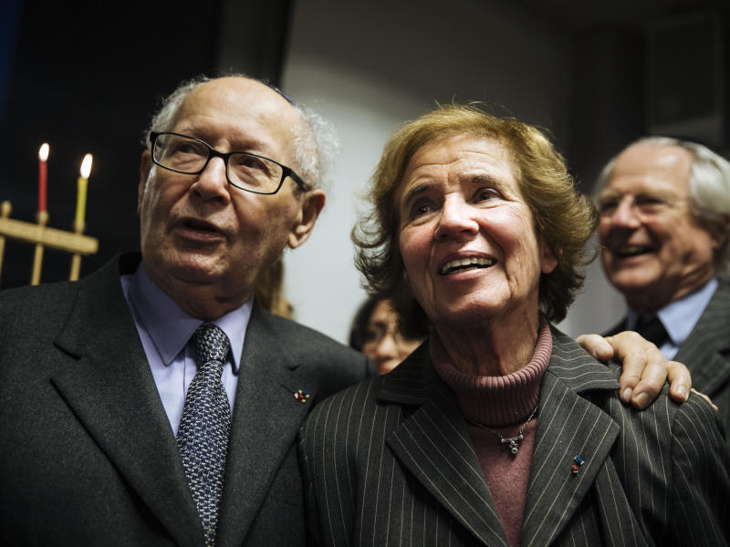 French nazi hunters Serge and Beate Klarsfeld during an event named 'Survivors Night' in Paris, Monday, Dec. 23, 2019. Holocaust survivors in several cities around the world are lighting candles for Hanukkah together, as Jewish community leaders try to keep first-hand memories of the Nazi horrors alive. The events were organized by the Conference on Jewish Material Claims Against Germany. (AP Photo/Kamil Zihnioglu)