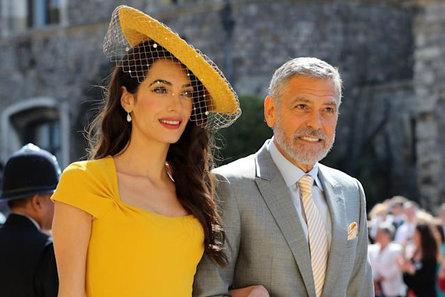Amal Clooney, at the royal wedding with her actor husband, George, was recognized for her work as a human rights lawyer. (Photo: Gareth Fuller — WPA Pool/Getty Images)