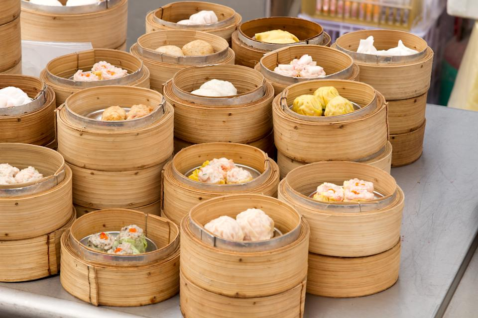 Steamed Dim Sum in Bamboo Trays by Local Street Food Vendors in Melaka Malaysia