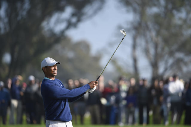 Tiger Woods hits his second shot on the second hole of the South Course at Torrey Pines Golf Course during the third round of the Farmers Insurance golf tournament Saturday Jan. 25, 2020, in San Diego. (AP Photo/Denis Poroy)