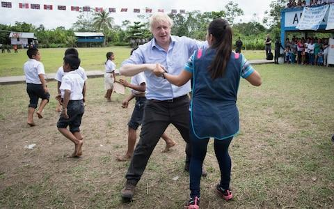 Boris Johnson dances with Peruvian children