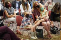 People look on during a news conference after a lawsuit was filed for a group of parents who sued the state of Utah Monday, Aug. 23, 2021, in Salt Lake City, to challenge a law that bans school districts from passing mask mandates. They say the law violates the educational rights of at-risk kids. (AP Photo/Rick Bowmer)