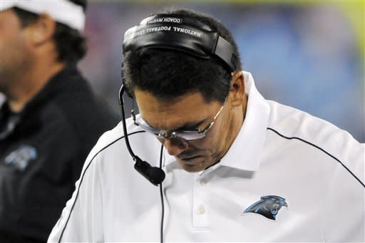 Carolina Panthers head coach Ron Rivera looks down on the sideline during the fourth quarter of an NFL football game against the New York Giants in Charlotte, N.C., Thursday, Sept. 20, 2012. The Giants won 36-7. (AP Photo/Mike McCarn)