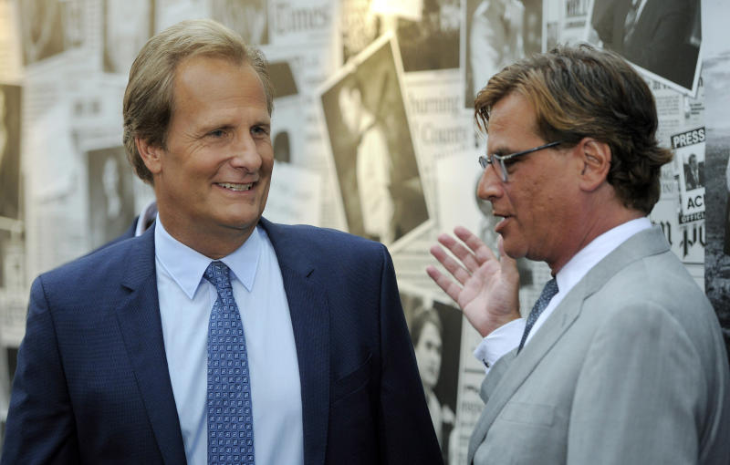 "Aaron Sorkin, right, creator/executive producer of ""The Newsroom,"" greets cast member Jeff Daniels at the season 2 premiere of the HBO series at the Paramount Theater on Wednesday, July 10, 2013 in Los Angeles. (Photo by Chris Pizzello/Invision/AP)"