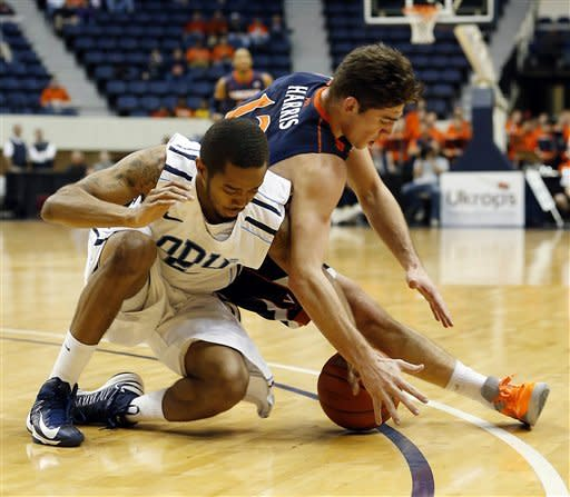 Old Dominion's Aaron Bacote, left, and Virginia's Joe Harris, right, scramble for a loose ball during first half action of an NCAA college basketball game in the 2012 Governor's Holiday Hoops Classic at The Richmond Coliseum in Richmond, VA.,Saturday,Dec.,22,2012. (AP PHOTO/ The Richmond Times-Dispatch, Joe Mahoney)