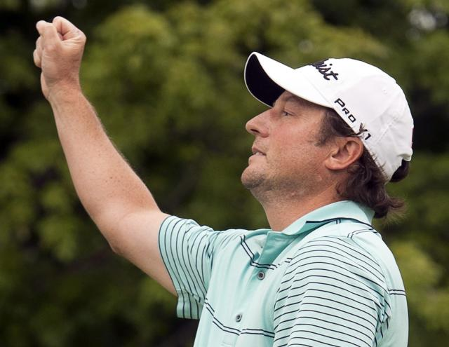 Tim Clark, from South Africa, reacts after winning the Canadian Open Championship after final round play at the Canadian Open golf championship Sunday, July 27, 2014. at Royal Montreal golf club in Montreal.(AP Photo/The Canadian Press, Ryan Remiorz)