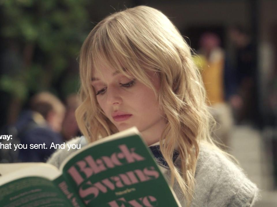 """Emily Alyn Lind reading a book on episode two of """"Gossip Girl."""""""