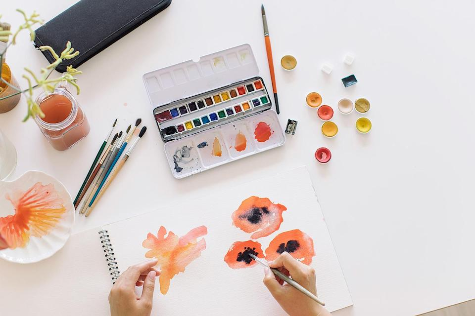 "<p>In May, I bought a <a href=""https://www.amazon.com/Watercolor-Palette-Bonus-Paper-GenCrafts/dp/B07QQ39F7J/"" rel=""nofollow noopener"" target=""_blank"" data-ylk=""slk:watercolor kit"" class=""link rapid-noclick-resp"">watercolor kit</a> when I decided that I needed a new hobby that wasn't burning bread in my new Dutch oven. </p> <p>Then, I bought an <a href=""https://www.amazon.com/Caydo-Embroidery-Starter-Pattern-Instructions/dp/B07WMM3DTS/"" rel=""nofollow noopener"" target=""_blank"" data-ylk=""slk:embroidery kit"" class=""link rapid-noclick-resp"">embroidery kit</a> when I decided to be an overachiever. I actually got pretty good at both, thanks to classes that I took through <a href=""https://learn.brit.co/collections"" rel=""nofollow noopener"" target=""_blank"" data-ylk=""slk:Brit +Co"" class=""link rapid-noclick-resp"">Brit +Co</a> and a lot of YouTube tutorials. </p>"