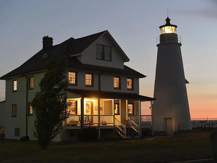 """Chesapeake Bay: home to great crab, wild ponies, and this 1828 beauty of a lighthouse that sleeps 16. With a generous kitchen, six beds, and a gorgeous slice of beach, it's booked through the end of the year but could be a perfect 2022 destination. $610, Airbnb. <a href=""""https://www.airbnb.com/rooms/32049729"""" rel=""""nofollow noopener"""" target=""""_blank"""" data-ylk=""""slk:Get it now!"""" class=""""link rapid-noclick-resp"""">Get it now!</a>"""