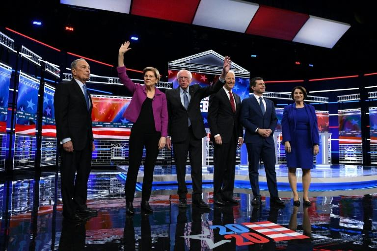 US presidential hopeful Mike Bloomberg (L), the former mayor of New York, joined his fellow Democrats on stage for the first time for their ninth debate of the party's nomination process on February 19 (AFP Photo/Bridget BENNETT)