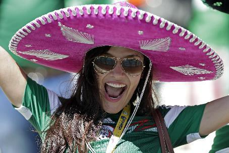A fan of Mexico cheers during the World Cup round of 16 soccer match between the Netherlands and Mexico at the Arena Castelao in Fortaleza, Brazil, Sunday, June 29, 2014. (AP Photo/Marcio Jose Sanchez)