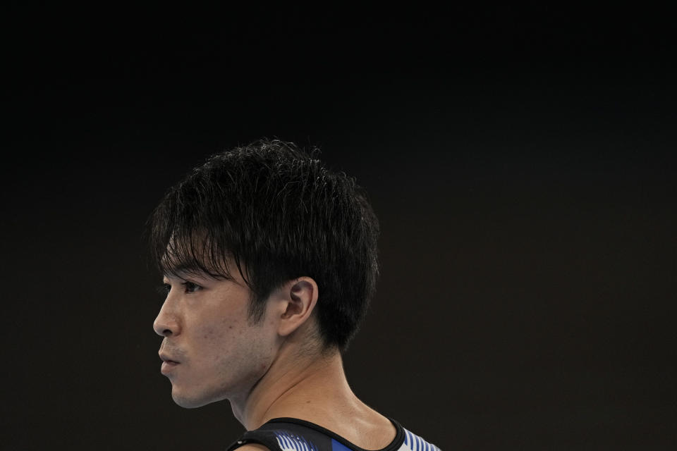 Kohei Uchimura, of Japan, watches performances during the men's artistic gymnastic qualifications at the 2020 Summer Olympics, Saturday, July 24, 2021, in Tokyo. (AP Photo/Natacha Pisarenko)
