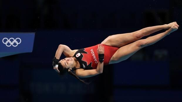 Canada's Meaghan Benfeito competes in women's 10-metre platform diving preliminaries at the Tokyo Olympics on Wednesday in Japan. Benfeito qualified for the semifinal with her performance. (Marko Djurica/Reuters - image credit)