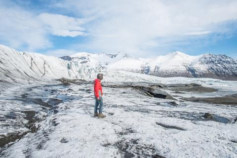 A tourist in Skaftafell national park - Credit: boyloso - Fotolia