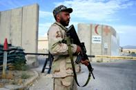 An Afghan National Army (ANA) soldier stands guard at gate of a hospital inside the Bagram US air base, from which American forces used to give air cover to Afghan troops fighting the Taliban, on July 5, 2021