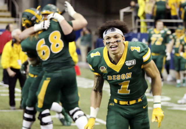 North Dakota State wide receiver Christian Watson (1) and teammates celebrate after their 42-14 win over Montana State in an FCS playoff NCAA college football game, Saturday, Dec. 21, 2019, in Fargo, N.D. (AP Photo/Bruce Crummy)