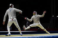 Ali Pakdaman of Iran, left, and Max Hartung of Germany compete in the women's individual Epee round of 16 competition at the 2020 Summer Olympics, Saturday, July 24, 2021, in Chiba, Japan. ((AP Photo/Hassan Ammar)